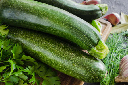 Organic zucchini, garlic and parsley, herbs and spices. Fresh farm products