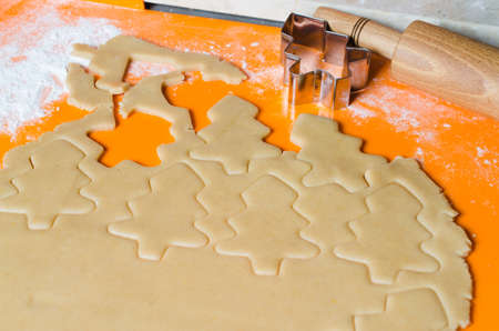 The process of making cookies and Christmas gingerbread at home. Dough for baking. Festive food, family culinary, Christmas and New Year traditions concept