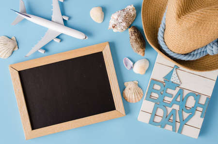 Empty chalkboard with seashells and decorative airplane. Summer travel concept. 写真素材