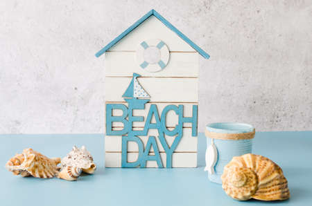 Decorative inscription beach day and seashells. Summer background. Summer vacation concept.