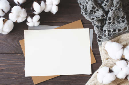 Mockup card with cotton flowers and scarf. Template invitation postcard. Natural, eco-friendly concept.