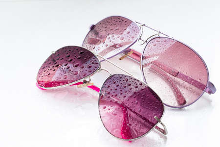 pink sunglasses and drops on an isolated white background Stock Photo