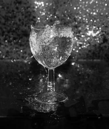 brit: squirt, splash of water on a black background, drops, glass Stock Photo