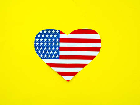 pictureframe: American flag in the shape of a heart on bright yellow background, USA, independence day