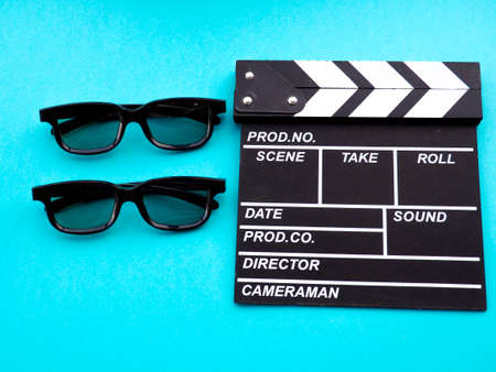 Movie clapperboard on blue background footage, background