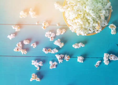 Popcorn texture. Popcorn snacks as background. on blue wood background Stock Photo