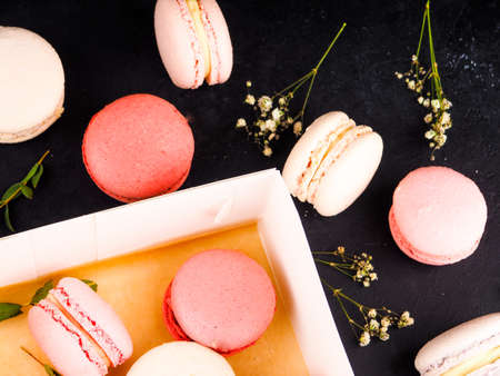 traditional french colorful macarons, dark background snack