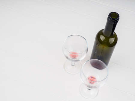 Two glasses of wine on white wooden background lie, copy space. Stock Photo
