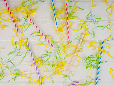 balloons, colored ribbons, and tubules for a cocktail, background holiday, bright
