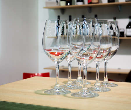Glasses of wine. Glasses hanging above the bar in the restaurant. Empty glasses for wine Archivio Fotografico
