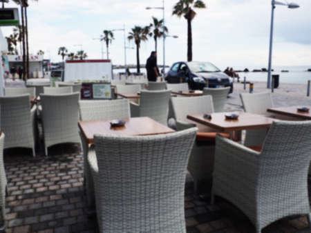 Street cafe and restaurant table and chair in Capri Island town in Italy at Naples. Landscape with Cafeteria at Italian coast. Anacapri in Europe. View in summer. Amalfi scenery.
