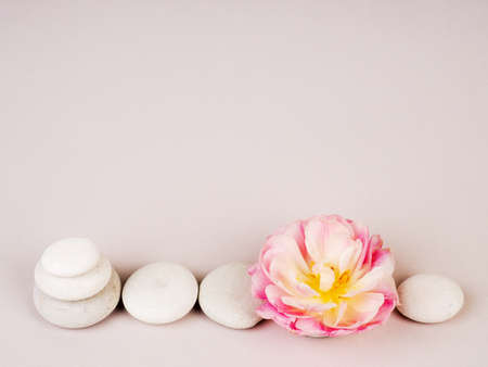 Spa still life with zen stones and flower, Harmony and balance, cairns, simple poise stones on gray background, rock zen sculpture. 写真素材