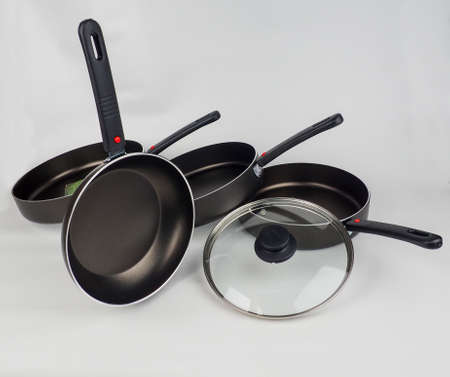 Cooking Pot and Frying Pans on White Background