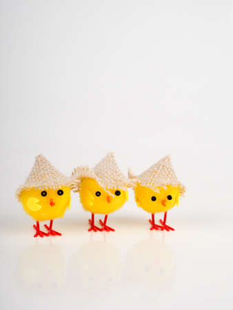 little baby toy chicken on a white background, a lot of chickens, the concept for Easter.