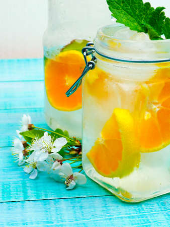 infused detox water with citrus and ice and mint for diet healthy eating and weight loss with space for a text 写真素材