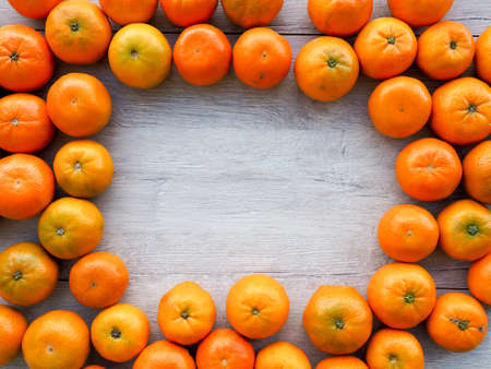 fresh Mandarin oranges as a background, cover, space for text