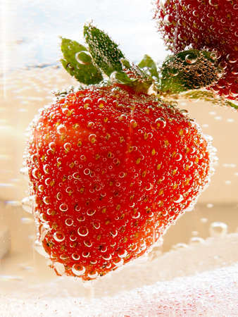 Sparkling wine champagne and strawberry on a white background