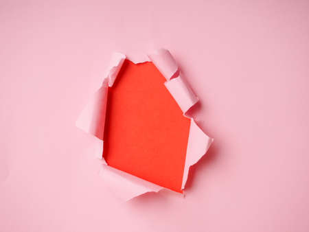 background with torn paper and place for your message, trending holes in paper.