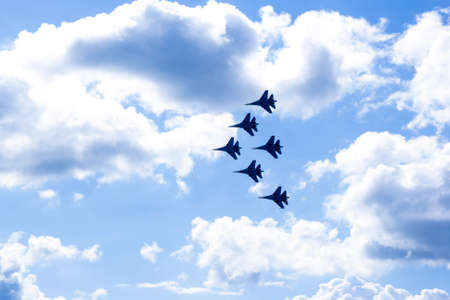 Three Airplanes In The Air, russian planes at airshow making figures in the sky, heart in the sky, loop, 写真素材