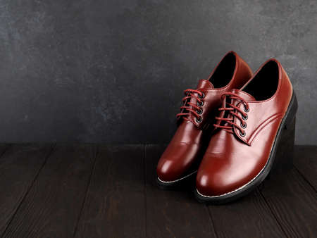 Stylish brown shoes for the groom. casual shoes on wooden background