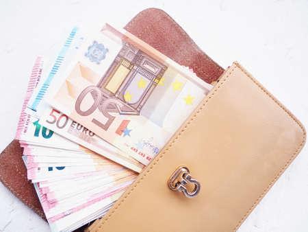 money euros and dollars in your wallet, open wallet, buyer and seller concept. Stock fotó