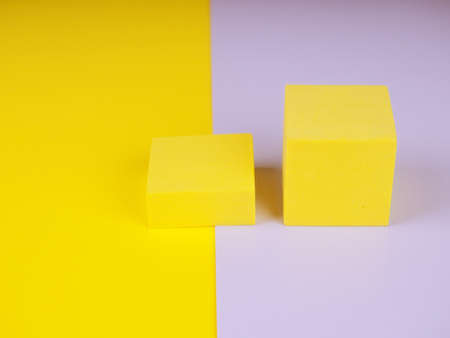 Two yellow squares on a gray and yellow background, pantone color.