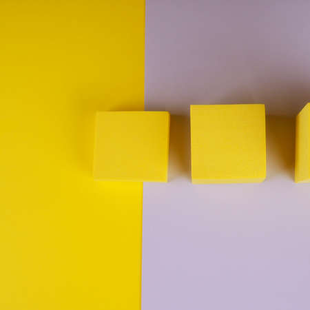 Three yellow squares on a gray and yellow background. 版權商用圖片