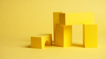 abstract squares on a yellow background with shadows, top view, geometric shapes for demonstration.