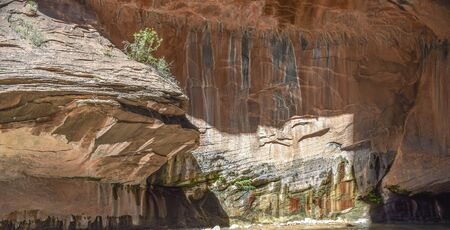 Grey, black,red and tan rock wall with patterns, Zion National Park, Utah