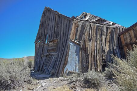 An old dilapidated dwelling, practically falling down in the historic ghost town, Bodie