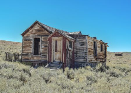 Dilapidated Prairie House, with a red door, in historic ghost town, Bodie Stock Photo