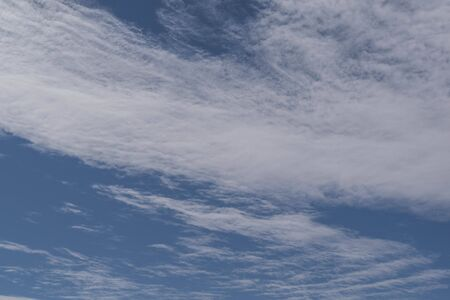 Isolated shot of wispy clouds and a deep blue sky Stock Photo