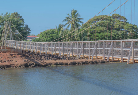 Historic pedestrian swinging bridge in Old Hanapepe Town, on Kauai Imagens