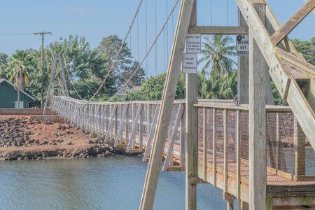 The pedestrian suspension bridge in the historical town of Hanapepe, on Kauai, Hawaii