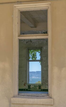 Unique view, looking through two window frames in an abandoned building Stock Photo