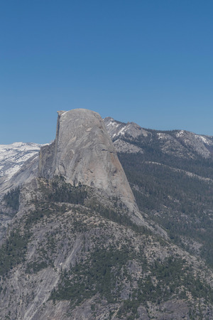 Side view of half dome, blue sky and surroundings, from glacier point, in Yosemite national park