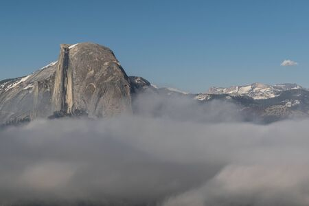 Shot of half dome, above the clouds, from Glacier Point, in Yosemite National Park Reklamní fotografie