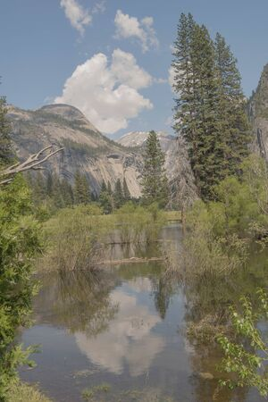 Reflection of a cloud and mountain, in Yosemite National Park