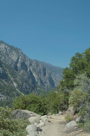 kings canyon national park: Copper Creek hiking trail, trees, and surrounding mountains, in Kings Canyon National Park Stock Photo
