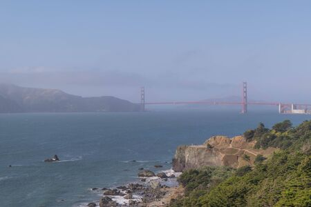San Francisco bay and the Golden Gate Bridge, on a foggy day, taken along the Lands End hiking trail
