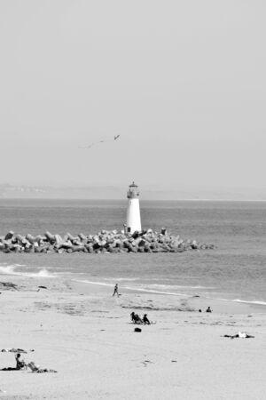 Black and white shot of the Walton Lighthouse, beach and ocean, in Santa Cruz,California Stock Photo