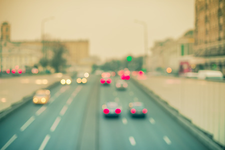 Defocused cityscape large highway with cars bokeh light toned vintage