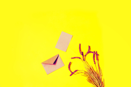 top view opened pink envelop and lavender flowers on yellow background  Stock Photo