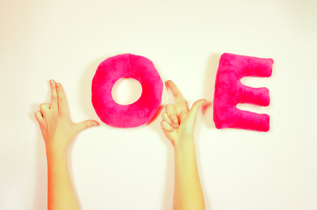 female hands forming Love word letters