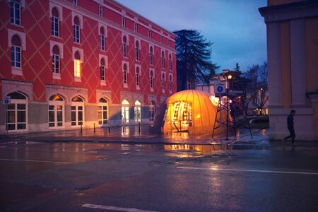 Tirana, Albania. February 12, 2018: City center sightseeing tourist attraction Bunk Art previously nuclear bunker during communism regime, rainy evening illuminated reflections 報道画像