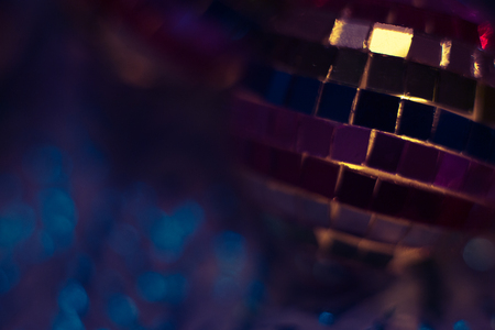 Colourful disco ball background close up