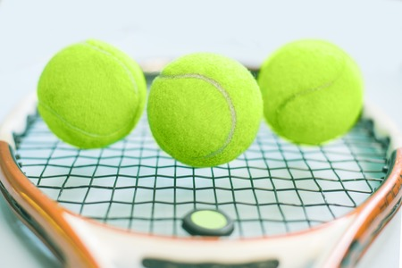 Closeup on ball on a tennis racket Stock Photo