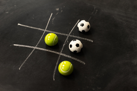 Abstract Tic Tac Toe game competition. Challenge concept on black board