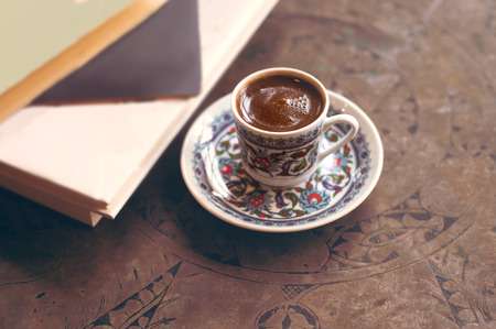 Turkish coffee with traditional cup top view