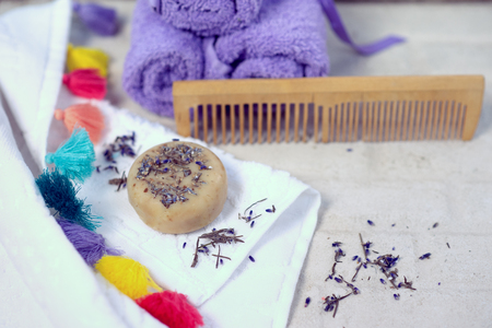 Spa and wellness setting with lavender flowers and handmade soap or shampoo bar, Dayspa nature set